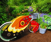A pollinator bike garden that was placed in a park around the Shaker Lakes