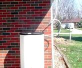 Cuyahoga SWCD rain barrel system (note elevation with concrete blocks)