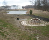Storm water conveyance swales and ditches aren't the best location for backyard fire pits