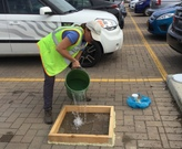 The author testing permeable pavers in Cleveland.