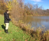 Intern Jon assists with a field assessment of an HOAs basin